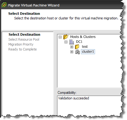 Migrating a VM to a cluster intelligently selects the best host.